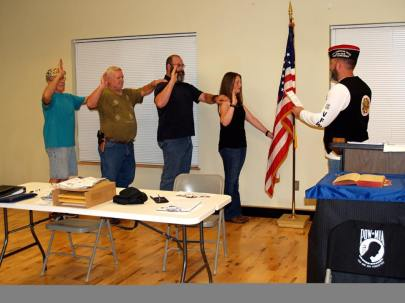 New VFW Post 688 members taking the Oath of Obligation.