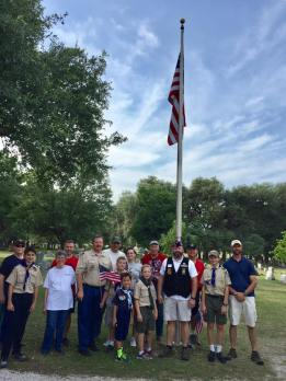 Putting flags on Boerne graves