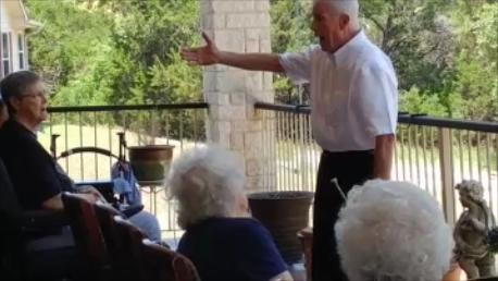 "Residents singing ""God Bless Americia"""